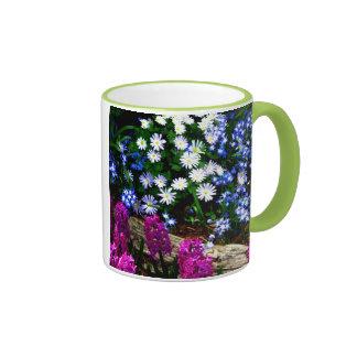 Productos púrpuras y blancos azules del diseño flo taza