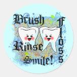 Profesionales dentales de los dentistas etiquetas redondas