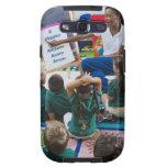 Profesor con los estudiantes preescolares en sala  galaxy SIII coberturas
