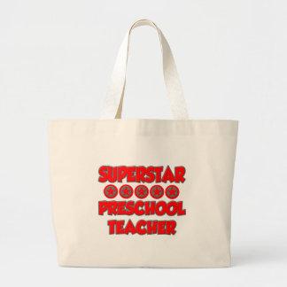 Profesor del preescolar de la superestrella bolsa