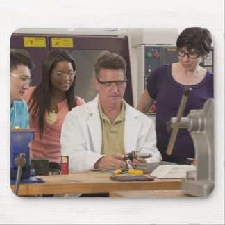 Professor demonstrating the tool holder from the mouse pad