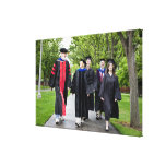 Professors and students walking to graduation canvas print