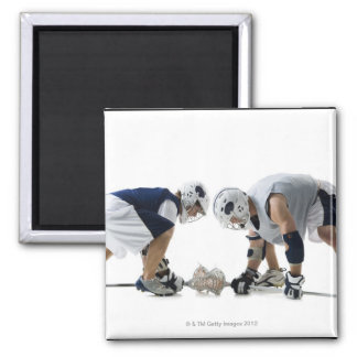 Profile of two young men playing lacrosse 2 inch square magnet
