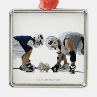 Profile of two young men playing lacrosse metal ornament