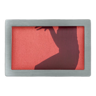 Profile shadow of woman on red wall rectangular belt buckle