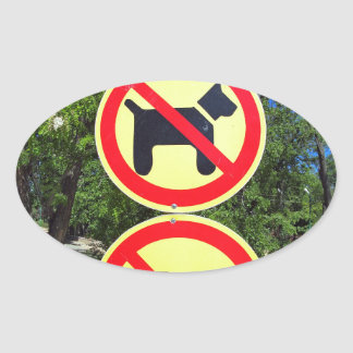 Prohibiting signs no-dogs and no-bikes in the park oval sticker