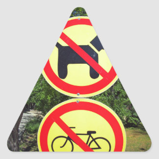 Prohibiting signs no-dogs and no-bikes in the park triangle sticker