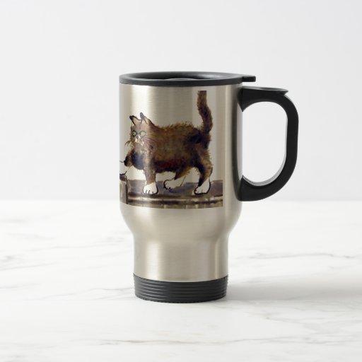 Prolongación del andén - el gatito camina en la ce tazas de café