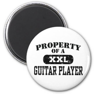 Property of a Guitar Player Refrigerator Magnets