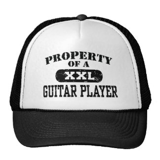 Property of a Guitar Player Trucker Hats