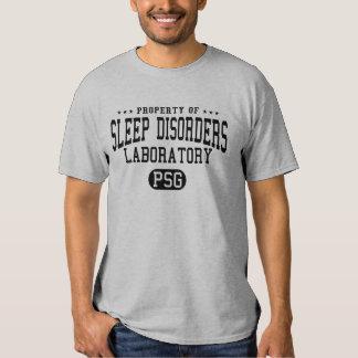 Propiedad de la camiseta del laboratorio de los playeras