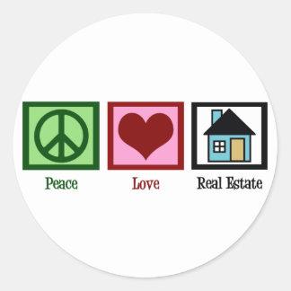 Propiedades inmobiliarias del amor de la paz pegatina redonda