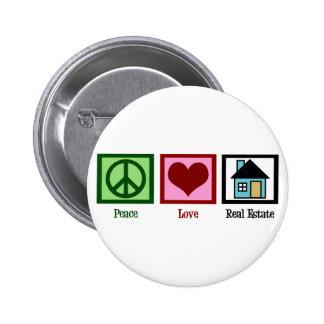 Propiedades inmobiliarias del amor de la paz pin redondo de 2 pulgadas