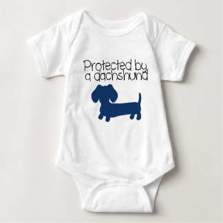 Protected by a Dachshund (blue) Baby Bodysuit