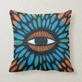 Protective eye graffiti in orange and blue pillows