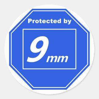 Protegido por 9m m pegatina redonda