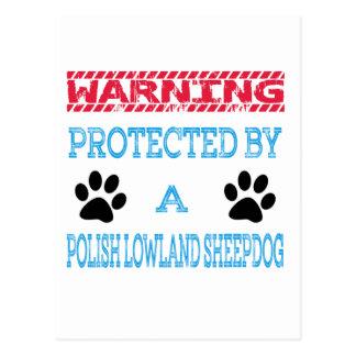 Protegido por un perro pastor polaco de la tierra postal