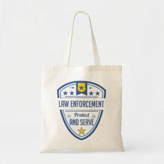 Proteja y sirva la insignia de la policía bolsa tela barata
