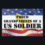 "Proud Grandparents of a US Soldier Yard Sign<br><div class=""desc"">Proud grandparents of a US Soldier yard sign features American flag stars on top and stripes on bottom, with a yellow ribbon in the background. Stencil font face and bright red white and blue colors. Show your neighbors that your grandson or granddaughter is serving in the US Military with this...</div>"