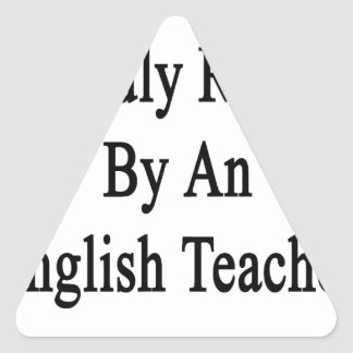 Proudly Raised By An English Teacher Triangle Sticker