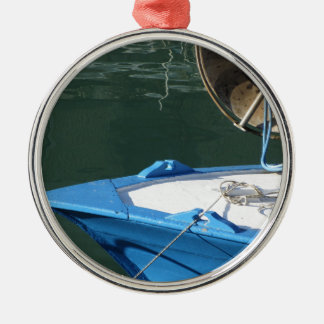 Prow of a wooden fishing boat with trawl winch metal ornament