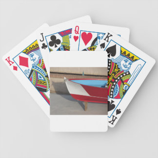 Prow of wooden racing boat with ten seats bicycle playing cards