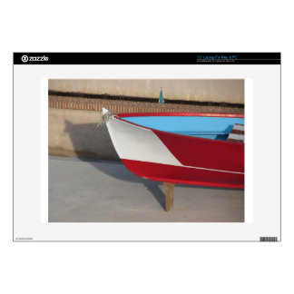 Prow of wooden racing boat with ten seats laptop skin