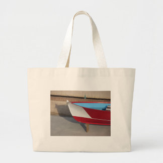 Prow of wooden racing boat with ten seats large tote bag