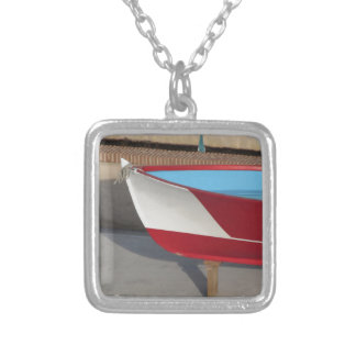 Prow of wooden racing boat with ten seats silver plated necklace