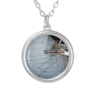 Prows of luxury sailboats moored in the harbor silver plated necklace