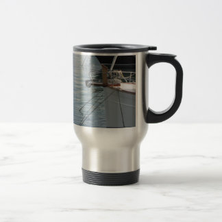 Prows of luxury sailboats moored in the harbor travel mug