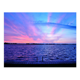 Psychedelic sunset with groovy colors postcard