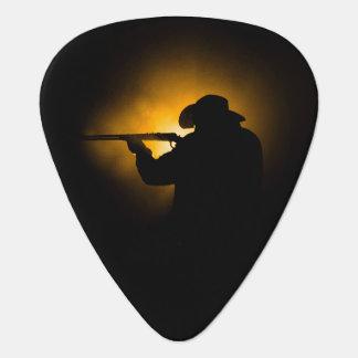 Púa de guitarra del vaquero del tiroteo