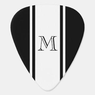 Púa de guitarra negra y blanca del monograma de la