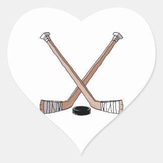 puck and hockey sticks design sticker