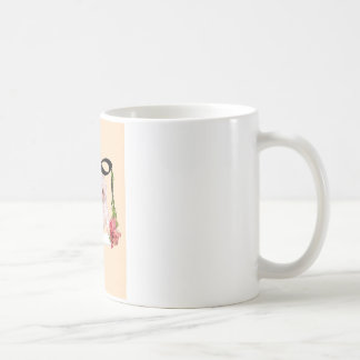 Puddle dog is rocking in a swing with flowers coffee mug