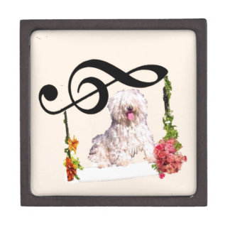 Puddle dog is rocking in a swing with flowers jewelry box