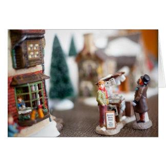 Pueblo de la miniatura de la calle del navidad felicitacion