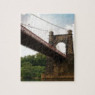 Puente colgante que rueda puzzle con fotos