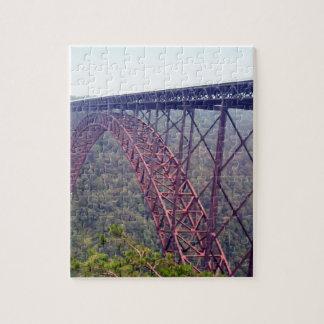 Puente de garganta de nuevo río puzzle con fotos