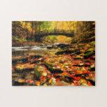 Puente de madera y cala en caída puzzle con fotos