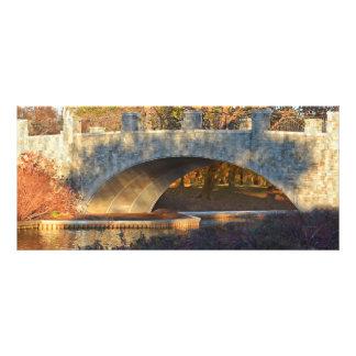 Puente pintado en la puesta del sol lonas publicitarias