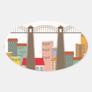 Puente sobre el río y la ciudad pegatina ovalada