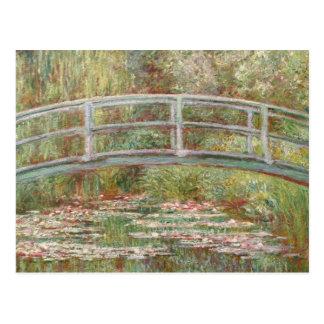 Puente sobre una charca de los lirios de agua tarjetas postales