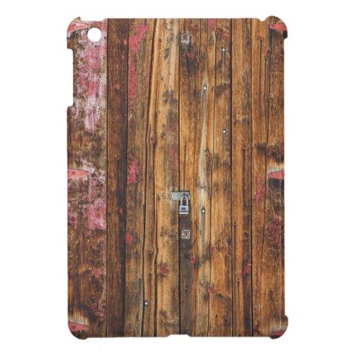 Puerta de madera vieja con seis bisagras rojas iPad mini protector