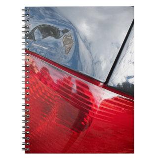 Puerta posterior abollada spiral notebook