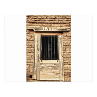 Puerta vieja de la cárcel en blanco y negro tarjeta postal