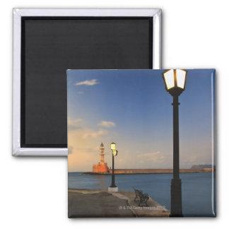 Puerto de Chania y faro veneciano en la puesta del Imán Cuadrado