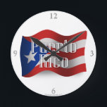 "Puerto Rico Waving Flag Round Clock<br><div class=""desc"">Represent Puerto Rico! This item features a wavy Puerto Rican flag in 3D. Do you know a Puerto Rican or Puerto Rican-American who misses their home country and culture and would like to be patriotic about their nation? Travellers to the Caribbean, Puerto Rican-Americans, or Puerto Ricans themselves will love to...</div>"