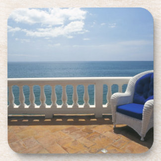 Puerto Rico. Wicker chair and tiled terrace at Coaster